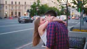 Meeting lovers date excitement thrill couple hug. Long awaited meeting. Young lovers date. Excitement and thrill. Couple hugging in the street stock footage