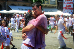 Meeting of lovers on the street in San Fermin. Meeting of lovers on the street on the first day of the festival of San Fermin, editorial use Stock Image