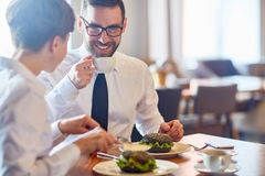 Meeting by lunch. Business people interacting by lunch in restaurant Stock Photo