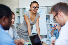 Meeting of managers. Contemporary managers planning work and analyzing data at briefing royalty free stock photos