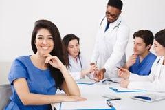 Meeting Of Medical Pros. Nurse Smiling To Camera At Meeting stock photo