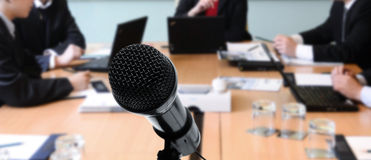Meeting with microphone. Microphone closeup during a business meeting Royalty Free Stock Image