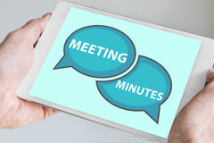 Meeting minutes concept with hands holding modern tablet or smartphone to be used as slide background Royalty Free Stock Photography