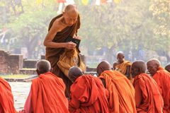 A meeting of monks at the holy tree in Lumbini - the birthplace of Lord Buddha stock photos