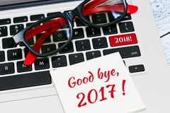 Meeting New Year 2018 concept. Leaving 2017 and meeting 2018 New Year IT technologies concept. Computer keyboard with a note on it and creative tagline button Royalty Free Stock Images