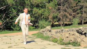 Meeting In A Park. Bride and groom meeting in a park stock footage