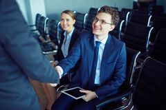 Meeting partner at conference Stock Image