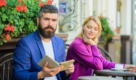 Meeting people with similar interests. Man and woman sit terrace. Literature common interest. Find person with common. Meeting people with similar interests. Man royalty free stock photography