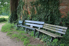 Meeting place with wooden benches at beautiful place in village. Meeting place with wooden benches at a beautiful place in a village royalty free stock image