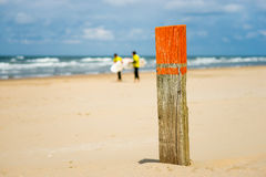 Meeting point on the beach. A pole on the beach for people to meet Royalty Free Stock Photos