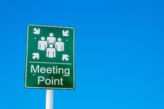 Meeting point green sign against a blue sky Royalty Free Stock Photography