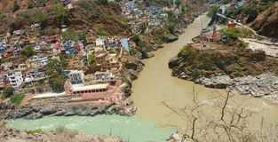 Meeting point of River in India. Alaknanda is on the right and Bhagirathi is on the left. Prayag means confluence.Devprayag--The Bhagirathi from Gaumukh and the royalty free stock image