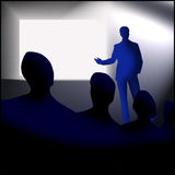 Meeting or presentation. An image showing a group of people in a meeting listening to a man giving a presentation in front of a screen Royalty Free Stock Photos