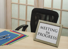 Meeting in progress sign Stock Photography