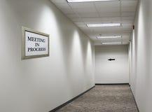 Meeting in progress sign in hallway stock photo