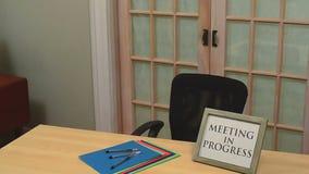 Meeting in progress sign Stock Image