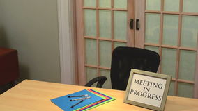 Meeting in progress sign Stock Photos