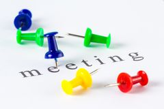 Meeting push pin. Push pin on paper at meeting word Royalty Free Stock Photography