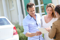 Meeting the real-estate agent. Couple meeting real-estate agent outside new property Stock Photo