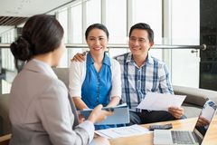 Meeting with real estate agent. Middle-aged couple at the meeting with real estate agent Stock Photo