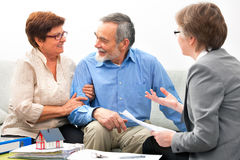 Meeting with real estate agent. Senior couple meeting with real estate agent Stock Image