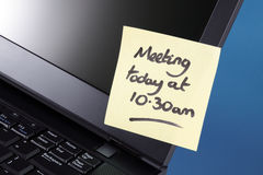 Meeting reminder on adhesive note Stock Images