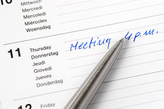 Meeting reminding note in calendar. Selective focus image stock photos
