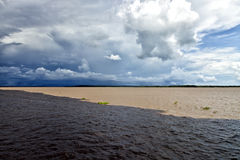 Meeting of the rivers in Amazon Brazil on a thunderstorm day Stock Images