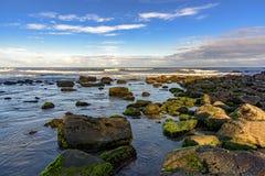 Meeting between the rocks and the sea. In Cal beach. Torres city, Rio Grande do Sul, bordering Santa Catarina Stock Photo
