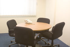 Meeting room. Small meeting room with table, chairs and telephone Royalty Free Stock Photo