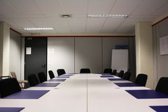 Meeting room. A gray, ordinary, empty meeting room Royalty Free Stock Photography