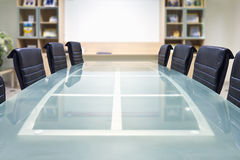 Meeting room. With glass top table and armchairs and white board Royalty Free Stock Photos