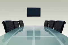 Meeting room. With glass top table , armchairs and television Stock Photography