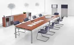 Meeting room. Modern meeting room interior with long wooden table and office chairs royalty free illustration