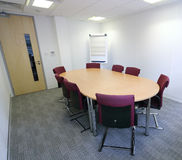 Meeting Room. A meeting room with table, chairs and flip chart Royalty Free Stock Photo