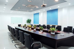 Meeting room. Bright meeting room with modern decoration and green plant