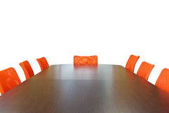 Meeting room. With brown table , orange armchairs , television and wood wall Stock Images