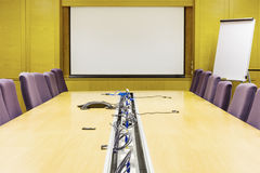 Meeting room. Armchairs and projector screen. Office interior Stock Photo