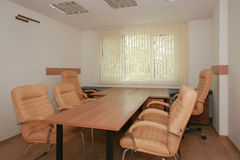 Meeting room. Small simply decorated meeting room stock photos
