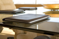 Meeting room. A brown documents case on a glass table Royalty Free Stock Photo