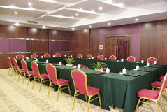 Meeting room. Night scenes of a meeting room with green tableclothes Royalty Free Stock Photography