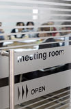 Meeting room. A full meeting room seen from outside the door royalty free stock photos