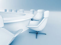 Meeting room. Rounded table is surrounded white leather chairs in a light room Stock Image