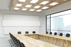 Meeting room in big company. Office room interior with long table, chairs, poster, windows and city view. Concept of board meeting. 3d rendering. Mock up Stock Photography