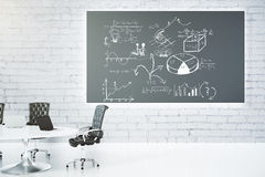 Meeting room with blackboard with business scheme concept. Mock up Royalty Free Stock Image