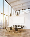 Meeting room with blank poster Royalty Free Stock Photos