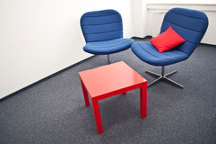 Meeting room. With blue chairs and red table in the modern office Royalty Free Stock Photo