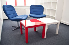 Meeting room. With blue chairs and red table in the modern office Stock Images