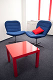 Meeting room. With blue chairs and red table in the modern office Stock Photography