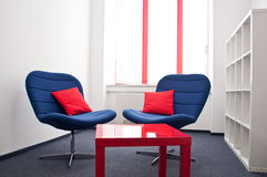 Meeting room. With blue chairs and red table in the modern office Royalty Free Stock Photos